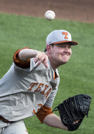 Photo - Texas starting pitcher Chad Hollingsworth delivers against UC Irvine in the first inning of an NCAA baseball College World Series elimination game in Omaha, Neb., Wednesday, June 18, 2014. (AP Photo/Nati Harnik)