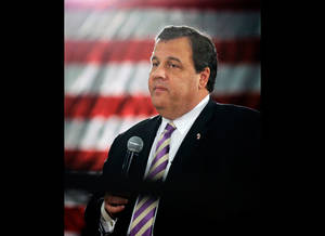 """Photo - FILE - In a Thursday, March 21, 2013 file photo, New Jersey Gov. Chris Christie speaks to a large gathering in Manasquan, N.J., during a town hall meeting. Christie said Monday, April 29, 2013 that President Barack Obama """"has kept every promise he's made"""" about helping the state recover from Superstorm Sandy. Speaking on MSNBC's """"Morning Joe"""" program on the 6-month anniversary of the deadly storm, the Republican governor said presidential politics were the last thing on his mind as he toured storm-devastated areas with Obama last fall. (AP Photo/Mel Evans, File)"""