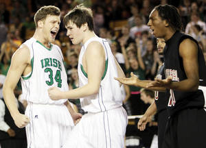 Photo - Matthew Christiansen (34) of McGuinness react after Matthew Ross (44) made a basket and was fouled by East Central's John McDavid (10), right, during the Class 5A boys high school basketball state tournament championship game between Bishop McGuinness and East Central at the Mabee Center in Tulsa, Okla., Saturday, March 10, 2012. McGuinness won, 54-41. Photo by Nate Billings, The Oklahoman