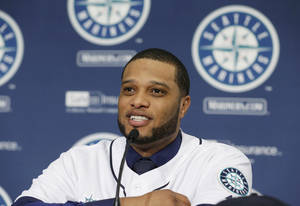 Photo - Robinson Cano talks to reporters after he was introduced as the newest member of the Seattle Mariners baseball team, Thursday, Dec. 12, 2013, in Seattle. (AP Photo/Ted S. Warren)