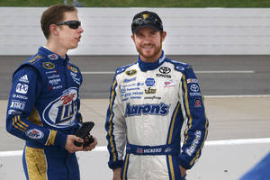 Photo - Brad Keselowski, left, and Brian Vickers talk before qualifying for the NASCAR Sprint Cup Series auto race, Saturday, March 31, 2012, at the Martinsville Speedway in Martinsville, Va. (AP Photo/Steve Sheppard) ORG XMIT: VASS207