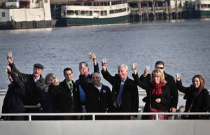 "Photo - Captain Chesley ""Sully"" Sullenberger III, fourth from right, pilot who safely glided U.S. Airways Flight 1549 with155 passengers and crew to a water landing 5 years ago, join survivors and rescuers in a toast marking the anniversary of the event known as the ""miracle on the Hudson,"" on Wednesday, Jan. 15, 2014 in New York.  (AP Photo/Bebeto Matthews)"