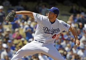 Photo -   Los Angeles Dodgers starter Clayton Kershaw pitches to the San Diego Padres in the second inning of a baseball game in Los Angeles, Sunday, April 15, 2012. (AP Photo/Reed Saxon)