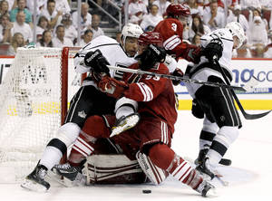 Photo -   Los Angeles Kings' Jordan Nolan (71) pulls Phoenix Coyotes' Derek Morris (53) down as Keith Yandle (3) and Kings' Brad Richardson (15) tangle in the second period during Game 2 of the NHL hockey Stanley Cup Western Conference finals, Tuesday, May 15, 2012, in Glendale, Ariz. (AP Photo/Ross D. Franklin)