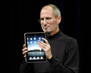 Photo -   FILE - In this Jan. 27, 2010 file photo, Apple CEO Steve Jobs shows off the new iPad during an event in San Francisco. Imagine the potential treasures inside the stolen iPad of the late Steve Jobs, secret corporate documents, personal correspondence and maybe even game prototypes. Professional entertainer Kenny the Clown, who unwittingly received the stolen tablet after the Apple co-founder's Palo Alto home was burglarized last month, says he never examined the touch-screen device's contents. The San Jose Mercury News says Kenny the Clown, whose real name is Kenneth Kahn, had no idea the iPad came from the Jobs residence until a friend who gave it to him was charged with burglary and police had confiscated the device. Authorities say 35-year-old Kariem McFarlin stole iPods, Macs, jewelry and Jobs' wallet. He is due in court Monday and recently hired a lawyer. (AP Photo/Paul Sakuma, File)