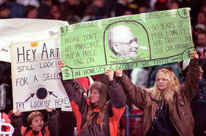 Photo -   FILE - This Nov. 26, 1995 file photo shows fans holding signs during a game against the Pittsburgh Steelers at Cleveland Stadium in Cleveland. 1995 file photo. Former Baltimore Ravens owner Art Modell has died. He was 87. The team said Modell died of natural causes early Thursday, Sept. 6, 2012, at Johns Hopkins Hospital, where he had been admitted Wednesday. Modell was among the most important figures in the NFL as owner of the Cleveland Browns, who became the Ravens after he took the team to Baltimore in 1996 _ a move that hounded him the rest of his life. (AP Photo/The Repository, Scott Heckel) MANDATORY CREDIT