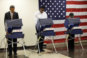Photo -   President Barack Obama, left, casts his vote during early voting in the 2012 election Thursday, Oct. 25, 2012, in Chicago, at the Martin Luther King Community Center. (AP Photo/Pablo Martinez Monsivais)
