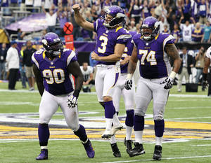 photo -   Minnesota Vikings kicker Blair Walsh (3) celebrates with Fred Evans, left, and Charlie Johnson, right, after kicking a field goal in the closing seconds of the second half of an NFL football game against the Jacksonville Jaguars, Sunday, Sept. 9, 2012, in Minneapolis. The Vikings won 26-23 in overtime. (AP Photo/Genevieve Ross)
