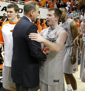 Photo - Oklahoma State's Keiton Page talks with Texas coach Rick Barnes after an NCAA college basketball game between Oklahoma State University (OSU) and the University of Texas (UT) at Gallagher-Iba Arena in Stillwater, Okla., Saturday, Feb. 18, 2012. Oklahoma State won 90-78. Photo by Bryan Terry, The Oklahoman