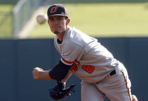 Photo - Oklahoma State's Andrew Heaney pitches against Oklahoma in the second inning of the Big 12 Conference baseball tournament in Oklahoma City, Wednesday, May 23, 2012. Oklahoma won 1-0. (AP Photo/Sue Ogrocki) ORG XMIT: OKSO102