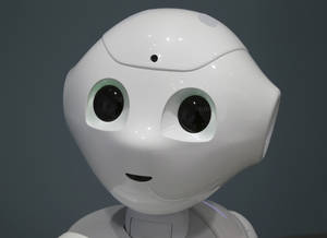 "Photo - Humanoid Robot ""Pepper"" is displayed at SoftBank Mobile shop in Tokyo, Friday, June 6, 2014. The 121 centimeter (48 inch) tall, 28 kilogram (62 pound) white Pepper, which has no hair but two large doll-like eyes and a flat-panel display stuck on its chest, was developed jointly with Aldebaran Robotics, which produces autonomous humanoid robots. (AP Photo/Koji Sasahara)"