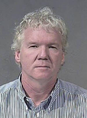 Photo - In this undated photograph provided by the Maricopa County Sheriff's Office, Michael Gilliland, the founder of Sunflower Farmers Market, is shown.  Gilliland was sentenced Tuesday, Jan. 8, 2013, to four weeks in jail for his guilty plea to misdemeanor attempted pandering.  Authorities say Gilliland agreed to pay $100 for sex in February 2011 in a police sting in which an undercover officer posed as a 17-year-old prostitute. Prosecutors say Gilliland showed up at a Phoenix hotel to meet the undercover even though she told the businessman during an earlier phone conversation that she was 17.  (AP Photo/Maricopa County Sheriff's Office)