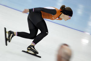 Photo - Speedskater Ireen Wust of the Netherlands trains at the Adler Arena Skating Center during the 2014 Winter Olympics in Sochi, Russia, Thursday, Feb. 6, 2014. (AP Photo/Peter Dejong)