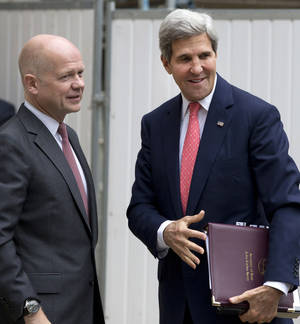 Photo - Britain Foreign Secretary William Hague, left, greets US Secretary of State John Kerry outside the Foreign Office in London,Monday, Sept. 9, 2013. (AP Photo/Alastair Grant, Pool)