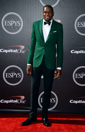 Photo - Oklahoma Thunder player Kevin Durant arrives at the ESPY Awards at the Nokia Theatre on Wednesday, July 16, 2014, in Los Angeles. (Photo by Jordan Strauss/Invision/AP)
