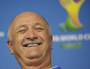 Photo - Brazil's coach Luiz Felipe Scolari laughs during a press conference one day before the group A World Cup soccer match between Brazil and Croatia at the Itaquerao Stadium in Sao Paulo, Brazil, on Wednesday, June 11, 2014. (AP Photo/Felipe Dana)