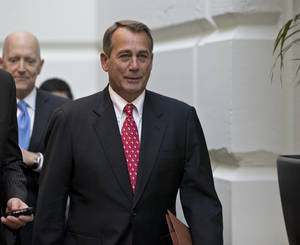 Photo - Speaker of the House John Boehner, R-Ohio, arrives for a closed-door meeting with House Republicans as he negotiates with President Obama to avert the fiscal cliff, at the Capitol in Washington, Tuesday, Dec. 18, 2012.   (AP Photo/J. Scott Applewhite)