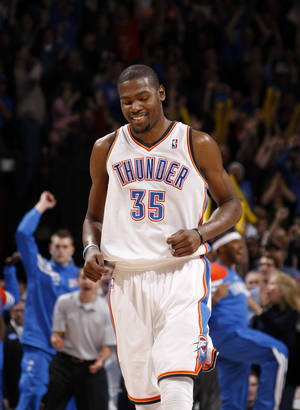 Photo - Oklahoma City's Kevin Durant (35) reacts after making a basket late in the fourth quarter of an NBA game between the Oklahoma City Thunder and the Memphis Grizzlies at Chesapeake Energy Arena in Oklahoma CIty, Friday, Feb. 3, 2012. Photo by Bryan Terry, The Oklahoman
