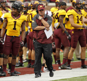 Photo - Minnesota head coach Jerry Kill walks the sidelines during the first quarter of an NCAA college football game against Western Illinois in Minneapolis, Saturday, Sept. 14, 2013. (AP Photo/Ann Heisenfelt)