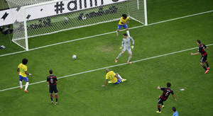 Photo - Germany's Sami Khedira, bottom, scores his side's 5th goal during the World Cup semifinal soccer match between Brazil and Germany at the Mineirao Stadium in Belo Horizonte, Brazil, Tuesday, July 8, 2014. (AP Photo/Felipe Dana, Pool)