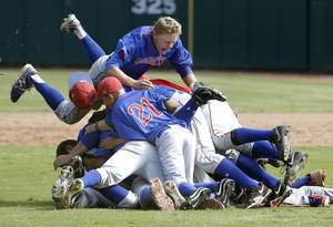 Photo - Binger-Oney players celebrate their win during the Class A fall baseball state championship game against Silo at the Chickasaw Bricktown Ballpark. Photo by Sarah Phipps, The Oklahoman