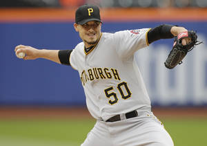 Photo - Pittsburgh Pirates' Charlie Morton delivers a pitch during the first inning of a baseball game against the New York Mets Wednesday, May 28, 2014, in New York. (AP Photo/Frank Franklin II)
