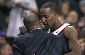 Photo - Oklahoma City Thunder center Kendrick Perkins, a former Boston Celtic, embraces Boston Celtics coach Doc Rivers before an NBA basketball game in Boston, Monday, Jan. 16, 2012. (AP Photo/Charles Krupa)