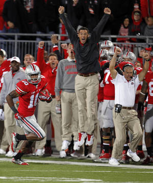 Photo -   Ohio State wide receiver Corey Brown (10) returns a punt for 76 yards for a touchdown in the second half of an NCAA college football game against Nebraska, Saturday, Oct. 6, 2012, in Columbus, Ohio. (AP Photo/Tony Dejak)
