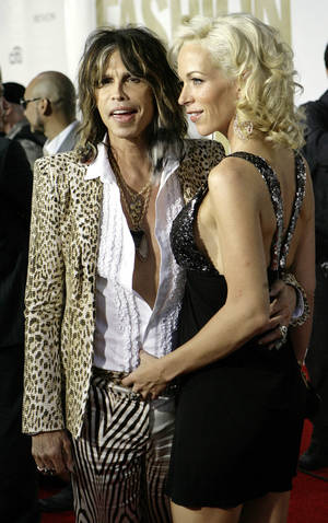 Photo - FILE — Aerosmith lead singer Steven Tyler and Erin Brady arrive at the fourth annual Fashion Rocks concert at Radio City Music Hall, in 2007. (AP Photo/Stuart Ramson)