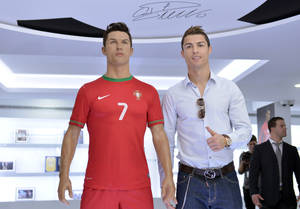 Photo - Cristiano Ronaldo poses next to a model of himself wearing the Portuguese national team kit during a tour of his museum in Funchal, Portugal, Sunday, Dec. 15 2013. The museum, opening Sunday, displays 150 of the soccer player's trophies and awards. (AP Photo/Helder Santos)