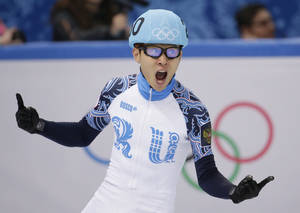 Photo - Victor An of Russia celebrates after his first place in the men's 500m short track speedskating final at the Iceberg Skating Palace during the 2014 Winter Olympics, Friday, Feb. 21, 2014, in Sochi, Russia. (AP Photo/Bernat Armangue)