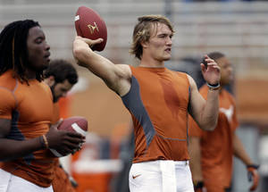 Photo - Texas quarterback David Ash, right, throws before an NCAA college football game against West Virginia, Saturday, Oct. 6, 2012, in Austin, Texas. (AP Photo/Eric Gay) ORG XMIT: TXEG101