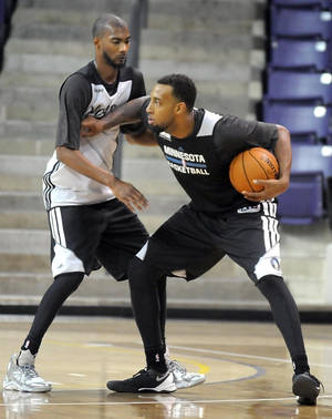 Photo - Minnesota Timberwolves' Derrick Williams is guarded by teammate Corey Brewer during the NBA basketball team's training camp Tuesday, Oct. 1, 2013, in Mankato, Minn. (AP Photo/Mankato Free Press, Pat Christman)