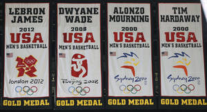 photo -   A banner commemorating Miami Heat forward LeBron James' participation on the gold-medal winning U.S. men's basketball team at this summer's London Olympics, far left, was unveiled during a ceremony before the start of an NBA basketball game against the Denver Nuggets, Saturday, Nov. 3, 2012 in Miami. His banner sways next to those honoring previous Heat players who were gold-medal winners: Dwyane Wade (2008), Alonzo Mourning (2000) and Tim Hardaway (2000). (AP Photo/Wilfredo Lee)