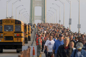 Photo -   Thousands of people head south during the annual Labor Day Mackinac Bridge Walk, Monday, Sept. 3, 2012. Gov. Rick Snyder has led thousands of walkers and runners across the bridge for one of Michigan's most popular Labor Day traditions. (AP Photo/John L. Russell)