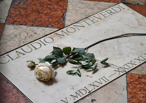 Photo - This April 13, 2014, photo shows the grave of composer Claudio Monteverdi in Venice, Italy. The grave is located in the church of Santa Maria Gloriosa dei Frari. Well-maintained tombs and other memorials for sculptors, musicians and writers located in many Italian cities are often works of art themselves. (AP Photo/Christopher Sullivan)