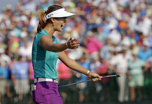 Photo - Michelle Wie reacts after winning the U.S. Women's Open golf tournament in Pinehurst, N.C., Sunday, June 22, 2014. (AP Photo/Chuck Burton)