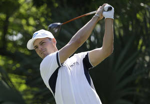 Photo - Martin Kaymer of Germany, hits from the fifth tee during the first round of The Players championship golf tournament at TPC Sawgrass, Thursday, May 8, 2014 in Ponte Vedra Beach, Fla. (AP Photo/Lynne Sladky)