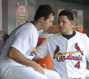 Photo - St. Louis Cardinals starting pitcher Michael Wacha is congratulated by teammate Yadier Molina (4) after the seventh inning against the Pittsburgh Pirates in a baseball game Sunday, Sept. 8, 2013, at Busch Stadium in St. Louis. (AP Photo/Bill Boyce)