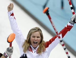 Photo - Canada's skip Jennifer Jones celebrates after delivering the last rock during the women's curling semifinal game against Britain at the 2014 Winter Olympics, Wednesday, Feb. 19, 2014, in Sochi, Russia. (AP Photo/Robert F. Bukaty)