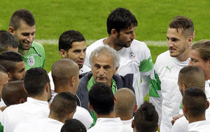 Photo - Algeria's head coach Vahid Halilhodzic, center, speaks to players before an official training session the day before the group H World Cup soccer match between South Korea and Algeria at the Estadio Beira-Rio in Porto Alegre, Brazil, Saturday, June 21, 2014.  (AP Photo/Lee Jin-man)