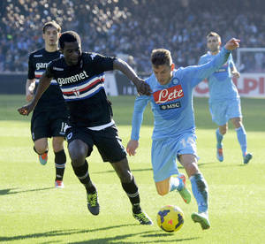 Photo - Napoli's Dries Mertens of Belgium, right, and Sampdoria's Pedro Obiang of Spain, vie for the ball during a Serie A soccer match between Napoli and Sampdoria, at the San Paolo stadium in Naples, Italy, Monday, Jan. 6, 2014. (AP Photo/Salvatore Laporta)