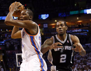 Photo - Oklahoma City's Kevin Durant (35) goes to the basket as he is defends by San Antonio's Kawhi Leonard (2) during Game 4 of the Western Conference Finals in the NBA playoffs between the Oklahoma City Thunder and the San Antonio Spurs at Chesapeake Energy Arena in Oklahoma City, Tuesday, May 27, 2014. Photo by Nate Billings, The Oklahoman