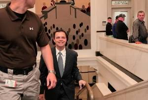 Photo - Stillwater Mayor Nathan Bates arrives smiling as he makes his way into a Payne County courtrroom before a judge unsealed an indictment against him, Monday afternoon, Sept. 27, 2010. A muticounty grand jury returned the indictment last week. Photo by Jim Beckel