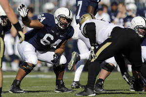 Photo - FILE - In this Nov. 16, 2013, file photo, Penn State guard John Urschel (64) lines up during the first quarter of an NCAA college football game against Purdue in State College, Pa. Urschel will routinely provide a look at his journey leading to the NFL draft on May 8, 2014, in a series of diary entries. (AP Photo/Gene J Puskar, File)