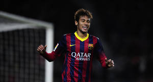 Photo - FC Barcelona's Neymar, from Brazil, reacts after scoring against Cartagena during a Copa del Rey soccer match at the Camp Nou stadium in Barcelona, Spain, Tuesday, Dec. 17, 2013. (AP Photo/Manu Fernandez)
