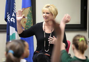 Photo - Joan Lunden talks to Girl Scouts from Arthur Elementary at the group's headquarters in Oklahoma City. Photo by David McDaniel, The Oklahoman <strong>David McDaniel - The Oklahoman</strong>