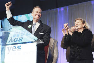 photo - Oklahoma City Mayor Mick Cornett celebrates Tuesday night with members of the city council, including Meg Salyer, right, after Cornett announced the passage of MAPS 3 during the Yes for MAPS watch party at the Cox Convention Center in Oklahoma City. Photo by Nate Billings, The Oklahoman
