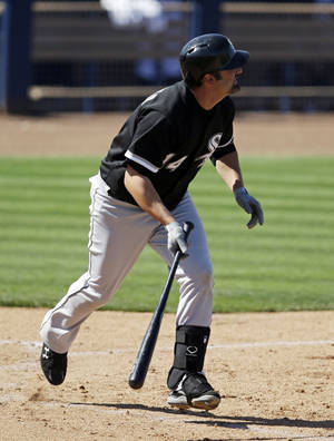 Photo - Chicago White Sox's Paul Konerko watches his two-run home run during the sixth inning of a spring exhibition baseball game against the Seattle Mariners, Monday, March 24, 2014, in Peoria, Ariz. (AP Photo/Darron Cummings)
