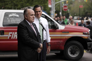 Photo -   Republican presidential candidate, former Massachusetts Gov. Mitt Romney, center, listens as former New York City Mayor Rudy Giuliani speaks during a news conference in front of Engine 24, Ladder 5 in New York, Tuesday, May 1, 2012. (AP Photo/Jae C. Hong)